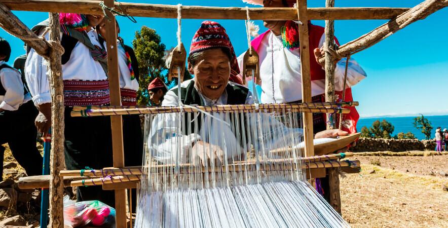 Weaver Taquile alpaca fiber Lake Titicaca Puno